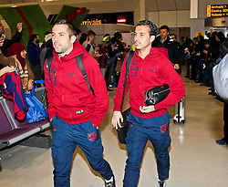 Jordi Alba (L) and Pedro Rodriguez (R) of FC Barcelona arrives at Manchester Airport with the squad ahead of the UEFA Champions League tie against Manchester City - Photo mandatory by-line: Matt McNulty/JMP - Mobile: 07966 386802 - 23/02/2015 - SPORT - Football - Manchester - Manchester Airport