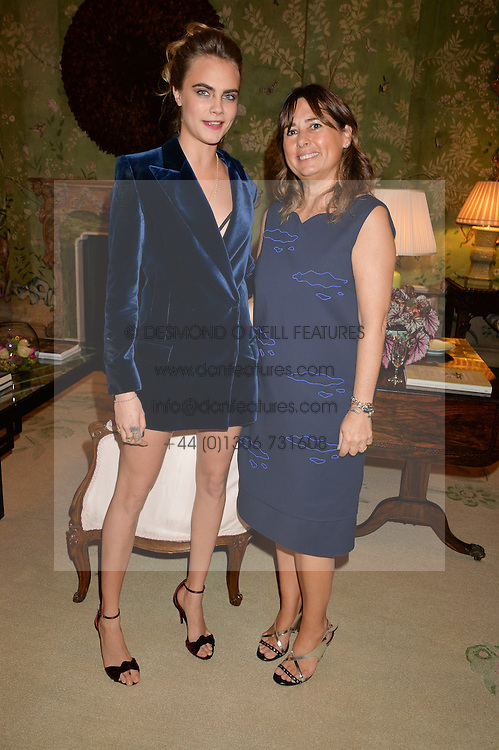 Left to right, CARA DELEVINGNE and ALEXANDRA SHULMAN at a party hosed by the US Ambassador to the UK Matthew Barzun, his wife Brooke Barzun and editor of UK Vogue Alexandra Shulman in association with J Crew to celebrate London Fashion Week held at Winfield House, Regent's Park, London on 16th September 2014.