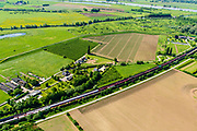 Nederland, Gelderland, Duiven, 29-05-2019; Groessen, Betuweroute met vrachttrein, verlaat de tunnel onder het Pannerdensch kanaal en is onderweg naar tunnel Zevenaar. <br /> Tunnel Betuweroute, freight railway, Pannerdensch channel.<br /> luchtfoto (toeslag op standard tarieven);<br /> aerial photo (additional fee required);<br /> copyright foto/photo Siebe Swart