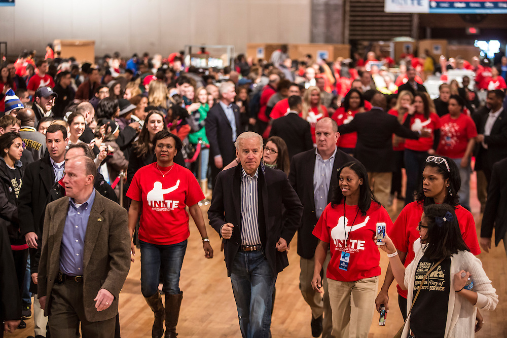 Vice President Joseph R. Biden, center, participates in the National Day of Service at the Unite America in Service event at the DC Armory on Saturday, January 19, 2013 in Washington, DC.