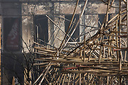 Twisted scaffolding amid smouldering remains of a construction site after an inner-city estate fire in south London. About 310 people were forced to leave their homes after the fire engulfed a wooden structure under construction in scaffolding at Sumner Road and Garrisbrooke Estate, Peckham, London at about 0430 AM. It spread to two blocks of maisonettes and a destroyed a pub. More than 150 firefighters tackled this unusually large and ferocious fire which injured ten people, including two police officers who received hospital treatment for minor injuries.  .