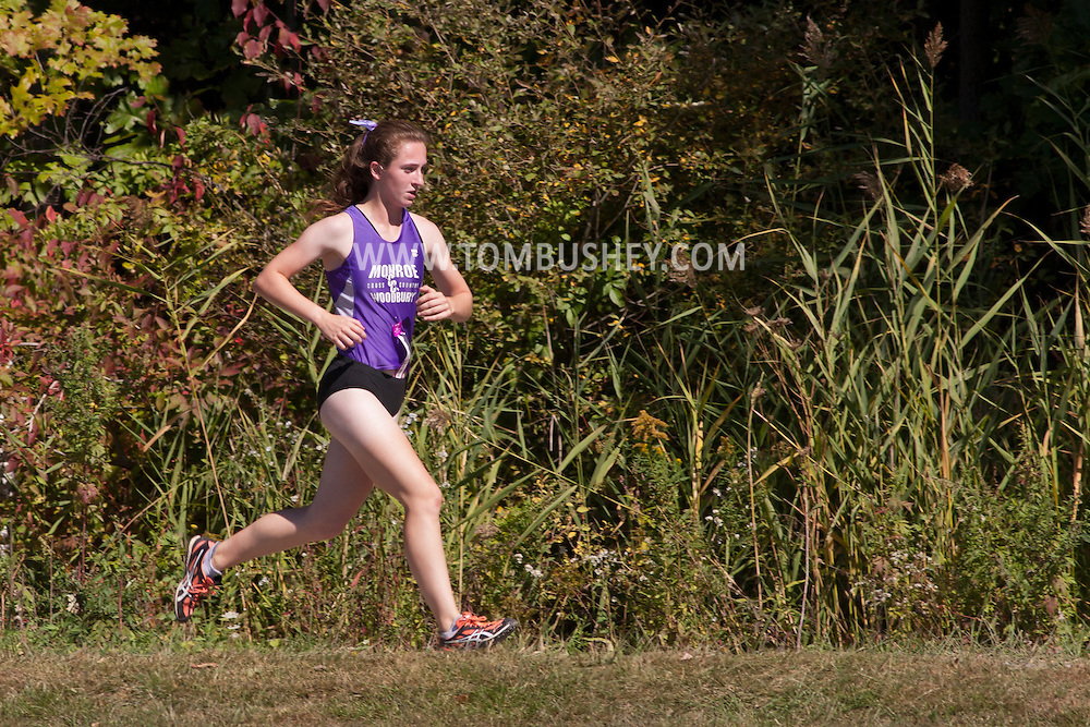 Central Valley, New York -  Monroe-Woodbury's Kathyn Munks, leads the varsity girls race at the first annual Crusader Classic invitational cross country meet on Sept. 27, 2014.
