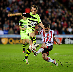 Sheffield United's Michael Doyle tackles Yeovil Town's Edward Upson - Photo mandatory by-line: Dougie Allward/JMP - Tel: Mobile: 07966 386802 03/05/2013 - SPORT - FOOTBALL - Bramall Lane - Sheffield - Sheffield United V Yeovil Town - NPOWER LEAGUE ONE PLAY-OFF SEMI-FINAL FIRST LEG