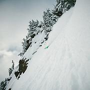 Tyler Hatcher drops off of Mount Herman as the clouds begin to break.