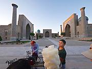 Uzbekistan, Samarqand.<br /> Registan ensemble. Sugar wool seller.