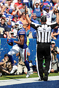 An official raises his arms signaling touchdown as Buffalo Bills wide receiver Andre Holmes (18) yells in celebration after catching a tipped pass for a second quarter touchdown and a 7-3 Bills lead during the 2017 NFL week 3 regular season football game against the against the Denver Broncos, Sunday, Sept. 24, 2017 in Orchard Park, N.Y. The Bills won the game 26-16. (©Paul Anthony Spinelli)