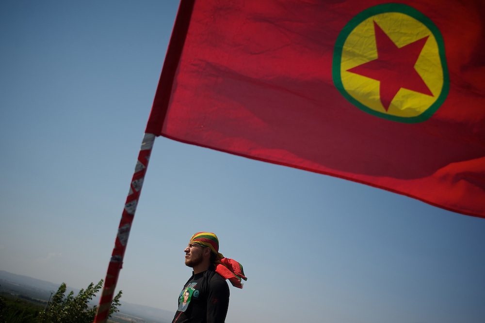 August 12, 2012 - Kafa Safra, Efrin, Syria: A Kurdistan Workers' Party (PKK) fighter takes guard outside a house where the funeral of a comrade is taking place near the village of Kafra Safra. Around five thousand Syrian Kurdish attended the funeral and ceremony of martyrdom of Taliz Gadalum, killed days earlier during combat against the Turkish army...PKK has been fighting an armed struggle against the Turkish state for an autonomous Kurdistan and greater cultural and political rights for the Kurds in Turkey, Iraq, Syria and Iran. Founded on 27 November 1978 in the village of Fis, was led by Abdullah Öcalan. The PKK's ideology was originally a fusion of revolutionary socialism and Kurdish nationalism - although since his imprisonment, Öcalan has abandoned orthodox Marxism. The PKK is listed as a terrorist organization by Turkey, the United States, the European Union and NATO. (Paulo Nunes dos Santos)