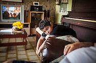 El hermano de Yuliana, Miguel Alejandro de 6 años descansa en casa de su abuelo paterno. Gracias a FundaHigado, Yuliana recibió un trasplante de higado que le permite disfrutar de la vida. Punto Fijo, Venezuela 26 y 27 Oct. 2012. (Foto/ivan gonzalez)