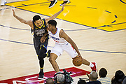 Golden State Warriors guard Shaun Livingston (34) defends LA Clippers guard Tyrone Wallace (12) at Oracle Arena in Oakland, California, on February 22, 2018. (Stan Olszewski/Special to S.F. Examiner)