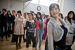 """Participants of """"Miss. International"""" beauty contest receive training on how to pose on stage in Beijing, China, Nov. 4, 2009."""