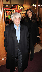 BERNIE ECCLESTONE and FABIANA FLOSI at the gala opening night of Cirque du Soleil's Varekai at the Royal Albert Hall, London on 5th January 2010.