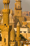 Egypt. Cairo elevated view.  - the northof historic cairo , the street sharia AL Mu'izz LI DIN Allah , mosque Ashraf BARSBAY,  the complex of Barquk Qalawun mosque - view from the minarets of THE GHURIYA, Al Ghuri mosque and khanqa complex  .Islamic Cairo  NM102