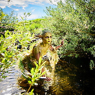 Fantasy water nymph in river with willow branches. Nymphs or Naiads are mythical river goddesses known as Potamides in Greek mythology.