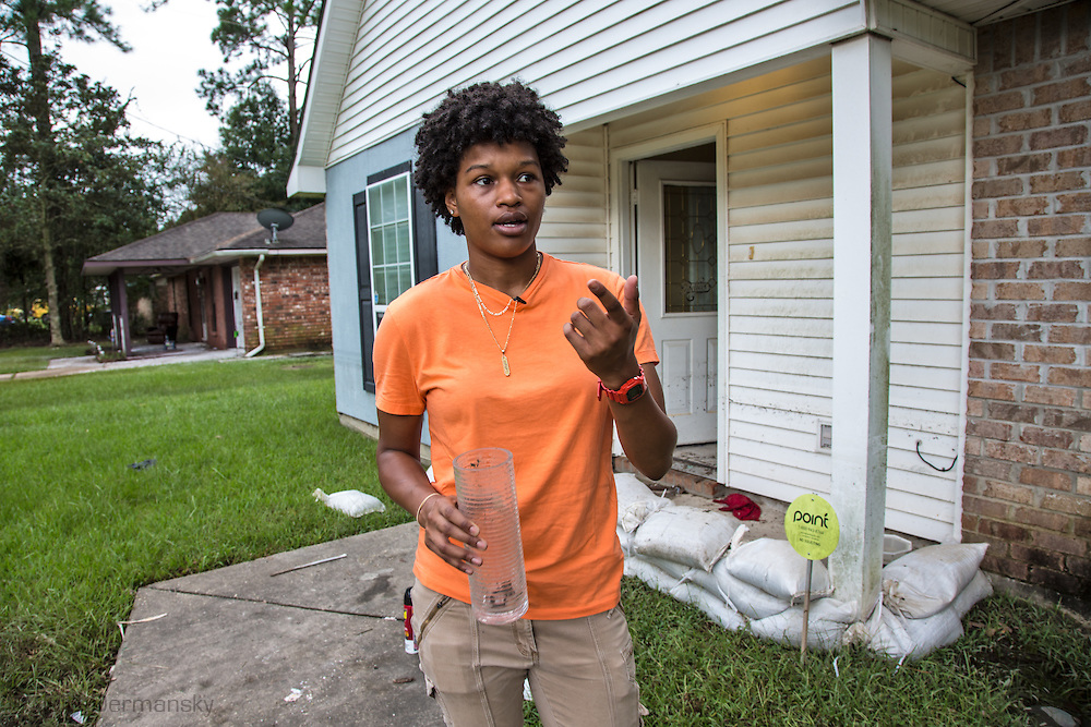 Aug 18, Tamara William's, a journalist at the Rouge Collection, holds a baby snake found  in her bedroom while her family cleans up their flooded home in Glen Oaks, Baton Rouge, an African American Neighborhood that was badly hit by the historic Louisiana floods