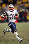PITTSBURGH - JANUARY 23:  Running back Corey Dillon #28 of the New England Patriots carried the ball 24 times for 73 yards and a touchdown against the Pittsburgh Steelers during the AFC Championship game at Heinz Field on January 23, 2005 in Pittsburgh, Pennsylvania. The Pats defeated the Steelers 41-27. ©Paul Anthony Spinelli  *** Local Caption *** Corey Dillon