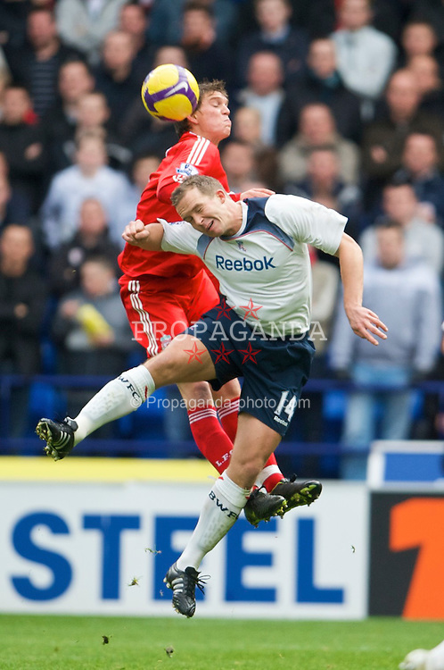 BOLTON, ENGLAND - Saturday, November 15, 2008: Liverpool's Daniel Agger and Bolton Wanderers' Kevin Davies during the Premiership match at the Reebok Stadium. (Photo by David Rawcliffe/Propaganda)