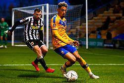 Kellan Gordon of Mansfield Town shields the ball from Jake Cottrell of Chorley - Mandatory by-line: Ryan Crockett/JMP - 09/11/2019 - FOOTBALL - One Call Stadium - Mansfield, England - Mansfield Town v Chorley - Emirates FA Cup first round