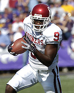 Oklahoma's Mark Clayton rushes up field against Kansas State at KSU Stadium in Manhattan, Kansas, Oct. 16, 2004.