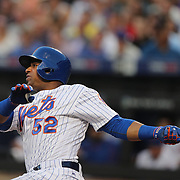 NEW YORK, NEW YORK - July 05: Yoenis Cespedes #52 of the New York Mets hits a solo home run in the fourth inning during the Miami Marlins Vs New York Mets regular season MLB game at Citi Field on July 05, 2016 in New York City. (Photo by Tim Clayton/Corbis via Getty Images)