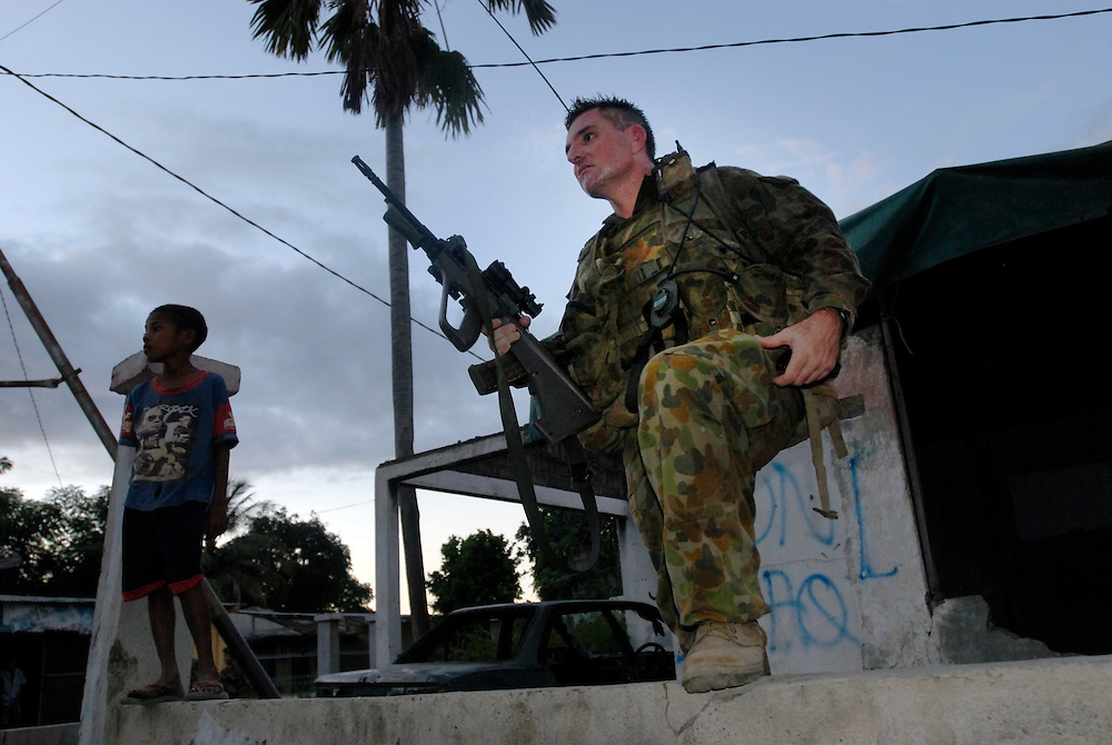Australian Peace Keepers patrol Dili's Bairo Pitie in order to prevent further clashes between rival gangs.