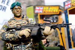 © under license to London News Pictures.  The London Toy Fair opened in Kensington Olympia today with the UK's largest single gathering of the worlds toy manufacturers showing their top merchandise for the year to come all under one roof. HM Armed Forces toys such as these were on display with a vast array of accessories, weapons and vehicles for all those action men in the world. Also on display amongst the  huge ranges of children's playthings were toys of the 2012 London Olympic Mascots Wenlock and Mandeville along side the new Team GB Mascot which will also be on sale during the London games..Photographer: Lee Durant.Date: 25/01/11