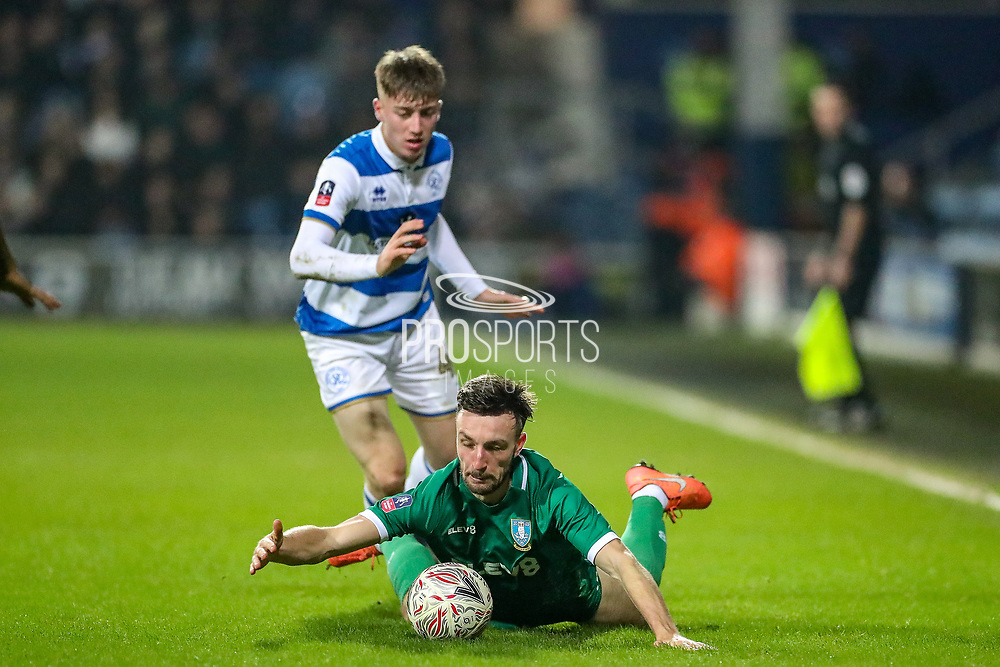 Sheffield Wednesday defender Morgan Fox (3) is brought down by Queens Park Rangers forward Jack Clarke (47) during the The FA Cup match between Queens Park Rangers and Sheffield Wednesday at the Kiyan Prince Foundation Stadium, London, England on 24 January 2020.