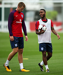 England's Raheem Sterling talks with Eric Dier - Mandatory by-line: Matt McNulty/JMP - 29/08/2017 - FOOTBALL - St George's Park National Football Centre - Burton-upon-Trent, England - England Training and Press Conference