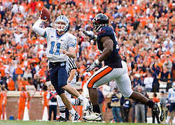 "North Carolina quarterback Cameron Sexton (11) throws a pass over Virginia linebacker Clint Sintim (51).  The Virginia Cavaliers defeated the #18 ranked North Carolina Tar Heels 16-13 in overtime in NCAA football at Scott Stadium on the Grounds of the University of Virginia in Charlottesville, VA on October 18, 2008.  The 113th meeting of the two teams, dubbed the ""Oldest Rivalry in the South"", saw UVA continue its streak of consecutive home victories over UNC -- the last time the Tar Heels won in Charlottesville was 1981."