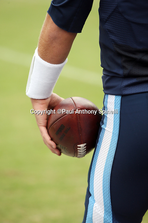A Tennessee Titans player holds a football at his side during the Tennessee Titans 2015 week 7 regular season NFL football game against the Atlanta Falcons on Sunday, Oct. 25, 2015 in Nashville, Tenn. The Falcons won the game 10-7. (©Paul Anthony Spinelli)