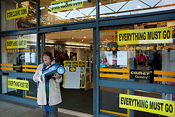 © Licensed to London News Pictures. 18/12/12. Coventry, UK. The Comet store closes in Coventry. Pictured, walking out of the store with a bargain, this lady bagged a vacumn cleaner for nine pounds, reduced from sixty pounds. Photo credit : Dave Warren/LNP
