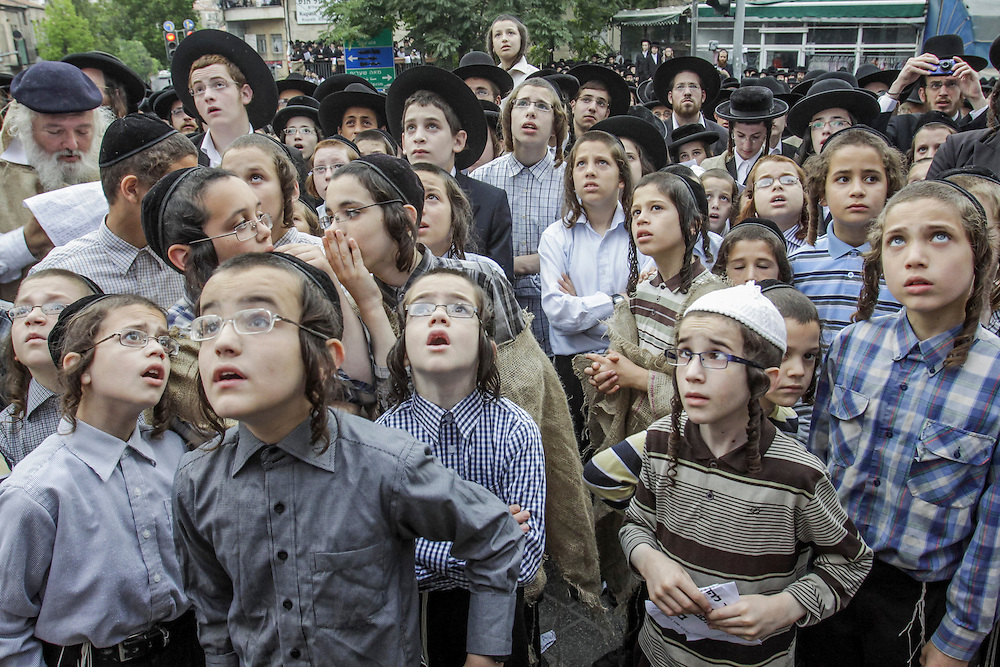 Ultra-Orthodox Jewish kids attend a protest, against a new conscription law that might force ultra-Orthodox Jews to serve in the army, in Jerusalem's Mea Shearim neighbourhood, June 25, 2012. Photo by Oren Nahshon.