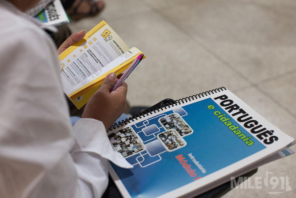 A student looks at a book during a portuguese lesson which is supported and funded by CAMI, an organistation that supports migrants in  São Paulo, Brazil.<br /> <br /> Each year, CAMI helps over 5,700 people to be legalised in the country. Their courses are attended by 500-700 people annually, while 12,000-14,000 immigrants take part in their events. They also distribute over 60,000 newspapers in the city.