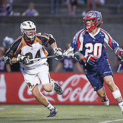 Owen Blye #20 of the Boston Cannons keeps the ball from Mike Lazore #24 of the Rochester Rattlers during the game at Harvard Stadium on August 9, 2014 in Boston, Massachusetts. (Photo by Elan Kawesch)