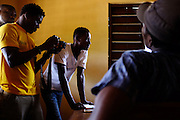AVEPOZO, TOGO  13-05-04   - Actor Eric Bah, centre, is filmed during a scene for 'My School' a TV series for Togolese Television. Director Adrien Kpan watches from the far left.  Photo by Daniel Hayduk