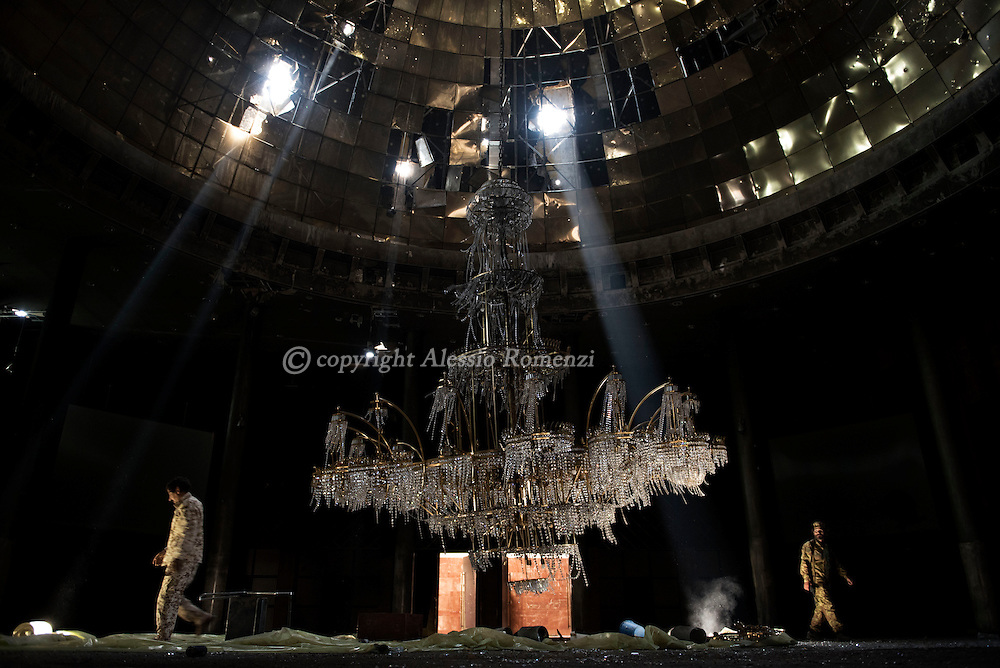 Libya, Sirte: fighters sympathising with Libya's Government of National Accord's (GNA) walk around the impressive chandelier of the conference room in Ouagadougou congress complex. Alessio Romenzi