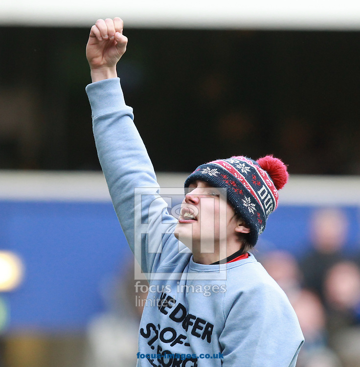 Picture by John Rainford/Focus Images Ltd +44 7506 538356<br /> 01/02/2014<br /> A pitch invader taunts the Burnley fans during the Sky Bet Championship match at the Loftus Road Stadium, London.