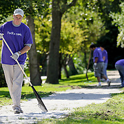 John Cronin, Corporate Account Manager at FedEx, joins colleagues as they help work on some landscaping at Hanson Center in Burr Ridge, Friday, Sept, 14, 2012.  About 40 local FedEx employees volunteered their time at the center as part of their company's global effort to give back to the communities they work in. Hanson Center, which is located on 13 acres of land, includes horses and other animals as well as hiking paths while catering to people with developmental disabilities. J.Geil ~ For Sun-Times Media