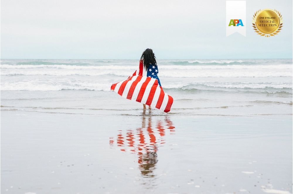 This award-winning image is part of a series that illustrates young women exploring freedom and power, igniting enthusiasm in beautiful landscapes with patriotic feels.