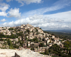 Distance view of hilltop village of Gordes, Luberon area of Provence, France.
