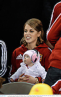 29 June 2013; Amy Huberman and daughter Sadie watch on ahead of the game. British & Irish Lions Tour 2013, 2nd Test, Australia v British & Irish Lions, Ethiad Stadium, Melbourne, Australia. Picture credit: Stephen McCarthy / SPORTSFILE