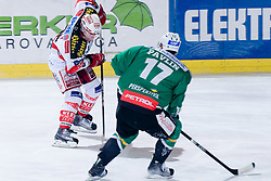 Kirk Furey (EC KAC, #25) vs Ziga Pavlin (HDD Tilia Olimpija, #17) during ice-hockey match between HDD Tilia Olimpija and EC KAC in 32nd Round of EBEL league, on December 30, 2010 at Hala Tivoli, Ljubljana, Slovenia. (Photo By Matic Klansek Velej / Sportida.com)