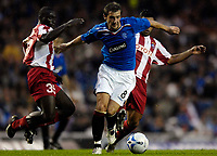 Photo: Jed Wee/Sportsbeat Images.<br /> Glasgow Rangers v Crvena Zvezda. UEFA Champions League Qualifying. 14/08/2007.<br /> <br /> Rangers' Kevin Thomson bursts through the Red Star defence.