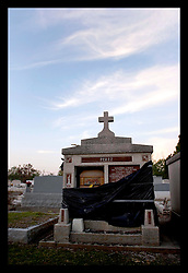 3rd November, 2005. A tomb still bearing a coffin at the Terre Aux Boaeufs (cattle land) cemetery in Saint Bernard parish just south of New Orleans. Hurricane Katrina caused a 20ft tidal surge to sweep over the land, 'popping' tombs and displacing coffins.