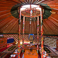 The interior of a yurt used for greeting guests in the grasslands of Inner Mongolia, Northern China.