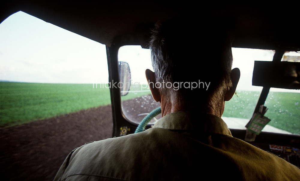 Sitting in the back seat of a jeep - the driver has very large ears, Krasnoyarsk, Siberia