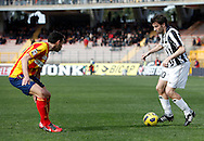 ITALY, Lecce :Del Piero J Brivio L during the Serie A match between Lecce and Juventus at Stadio Via del Mare in Lecce on February 20, 2011. .AFP PHOTO / GIOVANNI MARINO