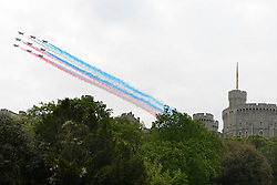 © Licensed to London News Pictures. 19/05/2012. WIndsor, UK The Red Arrows display team fly above Windsor Castle. Armed Forces muster and parade in Windsor today , 19th May 2012, in tribute to Her Majesty the Queen for the Diamond Jubilee. 2,500 troops paraded through the town before the Queen and Duke of Edinburgh to mark the Diamond Jubilee. Once the parade has passed the Queen and Duke traveled along the same route to an arena within Home Park, where the troops mustered. A tri-service flypast of 78 aircraft, including helicopters, Hawks, the Battle of Britain Memorial Flight, the Red Arrows and Tornados went overhead. Photo credit : Stephen Simpson/LNP