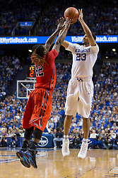 Kentucky guard Jamal Murray, right, shoots over Ole Miss guard Stefan Moody in the first half. The University of Kentucky hosted Ole Miss, Saturday, Jan. 02, 2016 at Rupp Arena in Lexington.