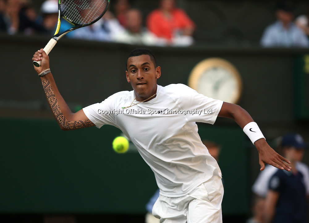 July 01 2014 Day  Eight: The Championships - Wimbledon 2014 <br /> Nick Kyrgios shows his highly decorated right arm.<br /> Photo: Mark Leech
