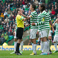 Celtic v St Johnstone.....11.05.13      SPL<br /> Referee Alan Muir checks the face of Mikael Lustig after he was caught in the face by Frazer Wright. Frazer Wright has today 14th May been issued with a SFA Notice of Complaint for elbowing Lustig in Saturday's match.<br /> Picture by Graeme Hart.<br /> Copyright Perthshire Picture Agency<br /> Tel: 01738 623350  Mobile: 07990 594431